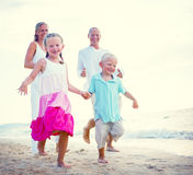 Family running on the beach Relaxation Concept Royalty Free Stock Images
