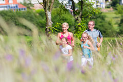 Family running for better fitness in summer Royalty Free Stock Photos