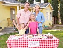 Family Running Charity Bake Sale. Smiling Stock Photo