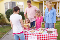 Family Running Charity Bake Sale. Smiling Royalty Free Stock Image