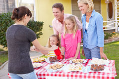 Family Running Charity Bake Sale. Smiling Royalty Free Stock Photography