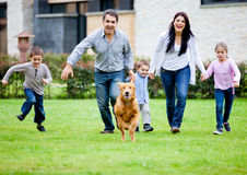 Family running with dog Stock Photo