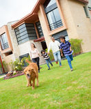 Family running with a dog Royalty Free Stock Photography