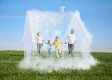 Family running on grass and dream house. Family of four running on grass and dream cloud house collage Stock Photo