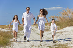 Family Running Having Fun At Beach Royalty Free Stock Photography