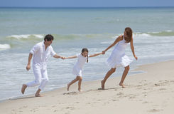 Family Running and Having Fun At the Beach Royalty Free Stock Photo