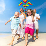 Family running with kite on beach Royalty Free Stock Photos