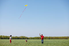 Family running with a kite Stock Photography