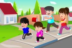 Family running outdoor in a suburban neighborhood Stock Image