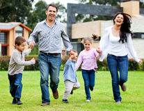 Family running outdoors Royalty Free Stock Image