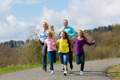 Family is running outdoors Royalty Free Stock Photo