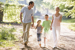 Family running outdoors holding hands and smiling Royalty Free Stock Images