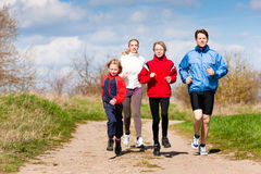 Family is running outdoors royalty free stock photography