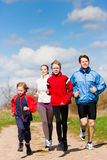 Family is running outdoors Royalty Free Stock Images