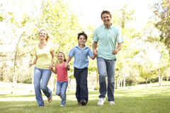 Family Running In Park royalty free stock photos