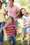 Family running in park Stock Image