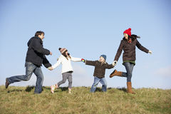 Family Running In The Park Royalty Free Stock Photos