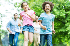 Family running in the park Royalty Free Stock Photography