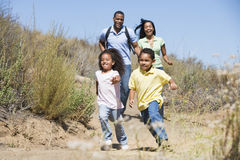 Family running on path smiling Stock Image