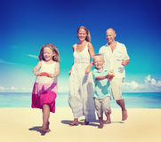Family Running Playful Vacation Beach Holiday Concept Stock Image