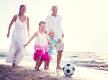 Family Running Playful Vacation Beach Holiday Concept Stock Images