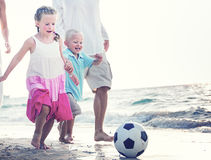 Family Running Playful Vacation Beach Holiday Concept.  royalty free stock photography