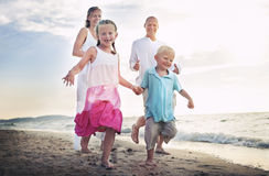 Family Running Playful Vacation Travel Holiday Concept.  royalty free stock image