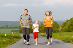 Family running for sport outdoors Royalty Free Stock Photos
