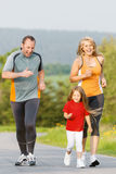 Family running for sport outdoors. Family jogging for sport for fitness outdoors with the kids Royalty Free Stock Photo