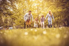 Family running trough park. royalty free stock photography