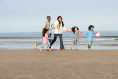 Family Running On Winter Beach Stock Photography