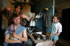 Family of Russian farmers, mother makes her son a haircut. Stock Images