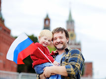 Family with russian flag with Moscow Kremlin on background Stock Images