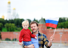 Family with russian flag with Moscow Kremlin on background Stock Image