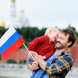 Family with russian flag with Moscow Kremlin on background Royalty Free Stock Image