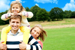 Family's day out in the park. Everyone enjoying Stock Photos