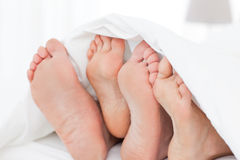 Family's feet in the bed Royalty Free Stock Photography
