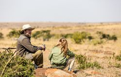 Family safari in Africa. Family of father and child on African safari vacation enjoying bush view stock photo