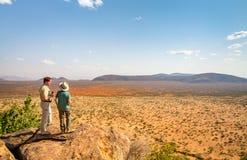 Family safari in Africa. Family of father and child on African safari vacation enjoying view over Samburu Kenya stock photos