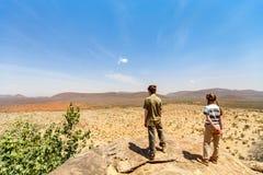 Family safari in Africa. Family of father and child on African safari vacation enjoying view over Samburu Kenya stock photo