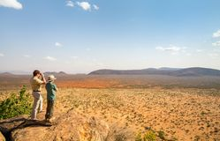 Family safari in Africa. Family of father and child on African safari vacation enjoying view over Samburu Kenya royalty free stock photo