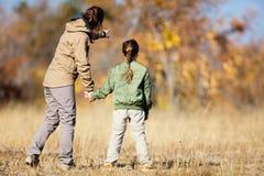 Family safari. Family of mother and child on African safari vacation enjoying bush view royalty free stock image