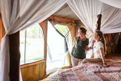 Family safari. Family mother and her child in safari tent enjoying vacation in Africa stock images