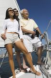 Family on sailboat Royalty Free Stock Images