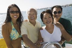 Family on sailboat. Asian ethnic Family on sailboat, (portrait Stock Photo