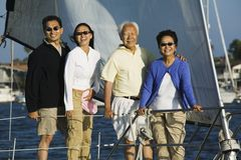 Family on sailboat (portrait) Stock Photo