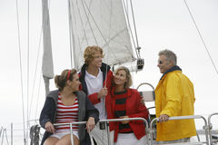 Family On Sailboat In Sea. Happy Caucasian family of four on sailboat in sea Stock Photo