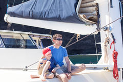 Family at sailing boat Royalty Free Stock Photos