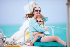 Family sailing on luxury yacht Stock Photos