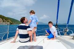 Family sailing on a luxury yacht Stock Photos
